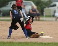 Softball player slides safely into third base