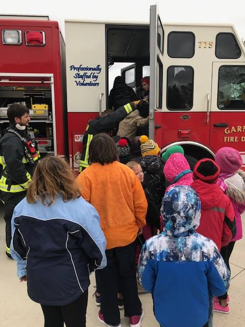 students getting into fire truck