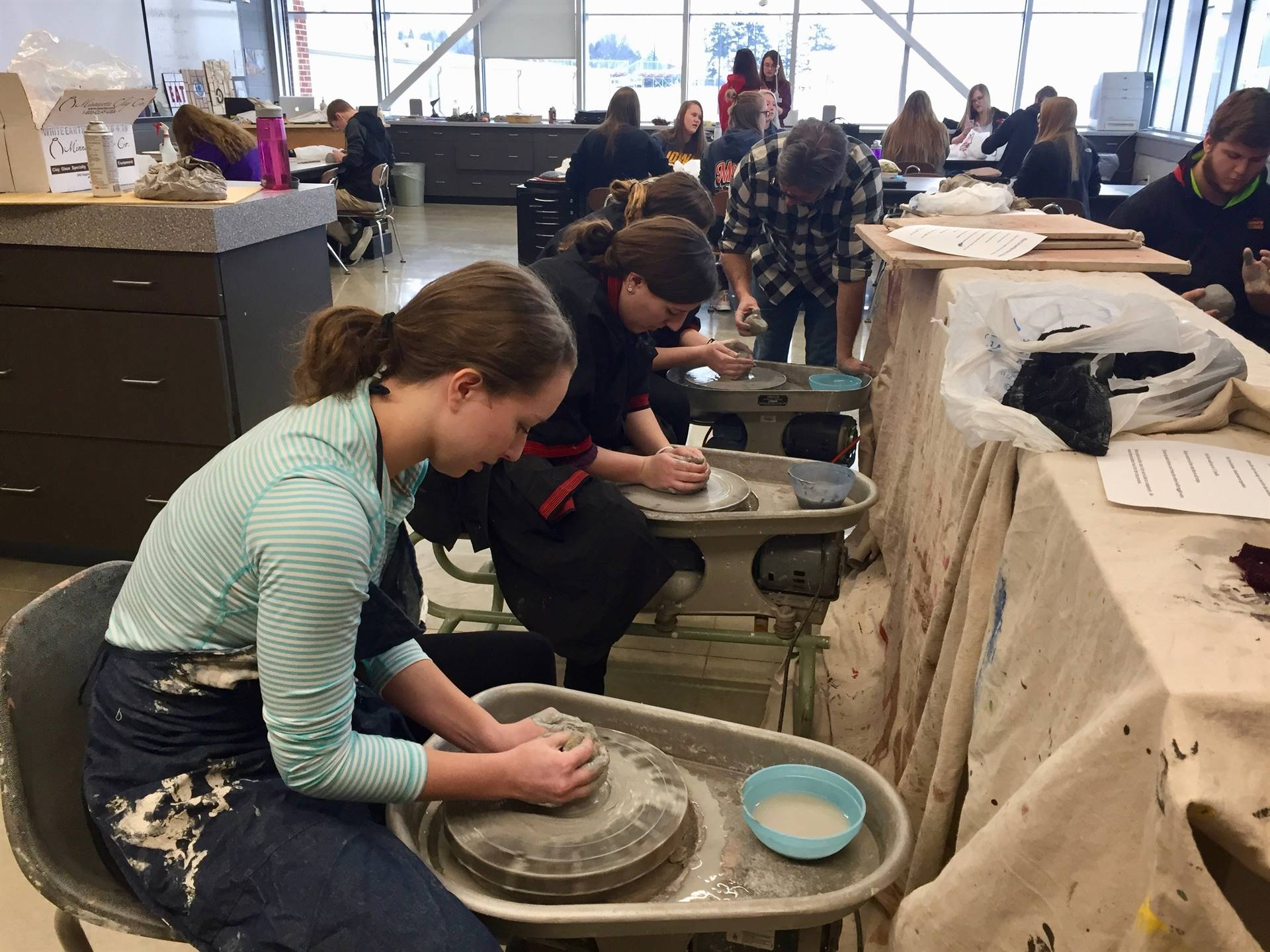 students working at pottery wheels