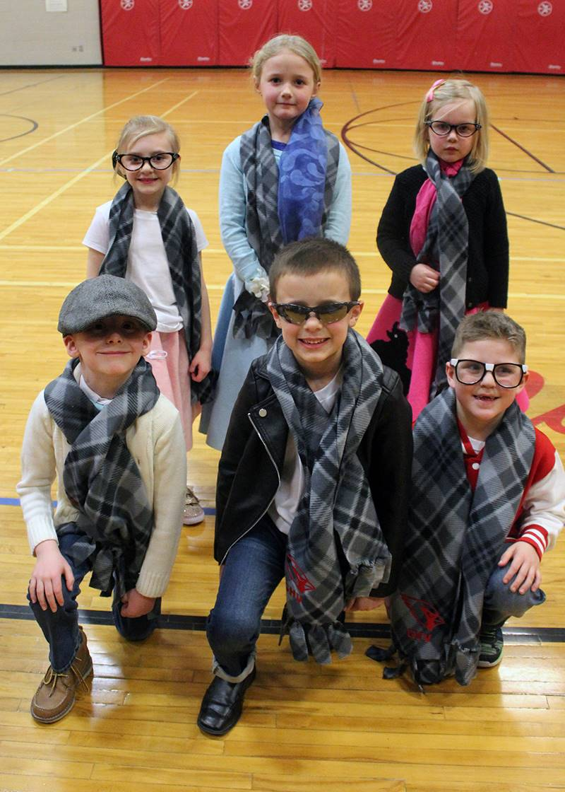 6 students dressed in 50's attire for sock hop