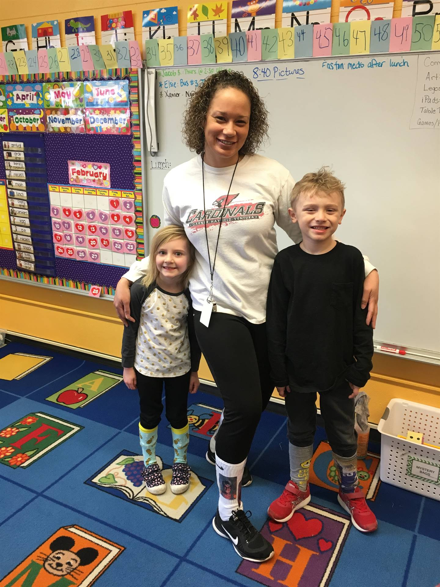 Picture of 2 students and staff member wearing crazy socks