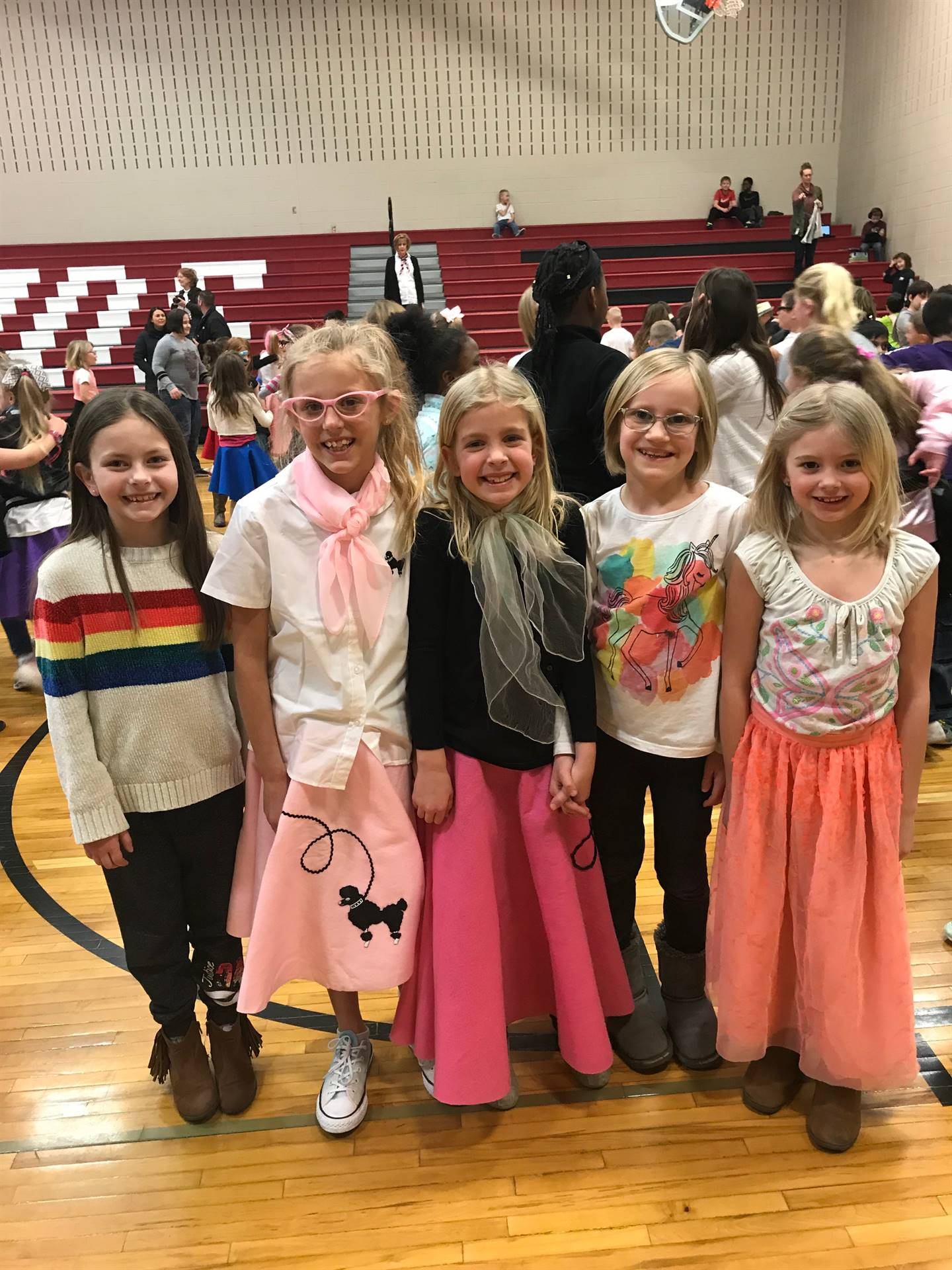 five elementary students dressed in 50's attire