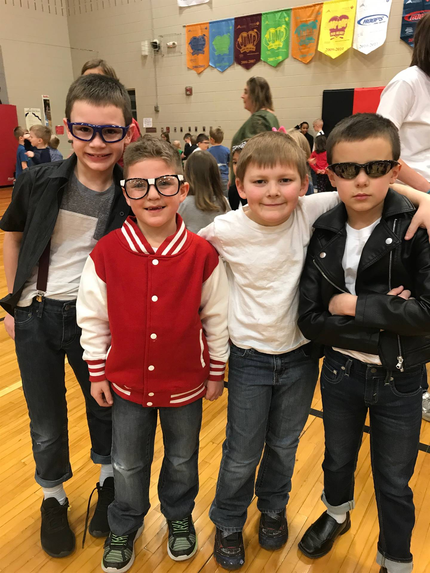 four elementary students dressed in 50's attire