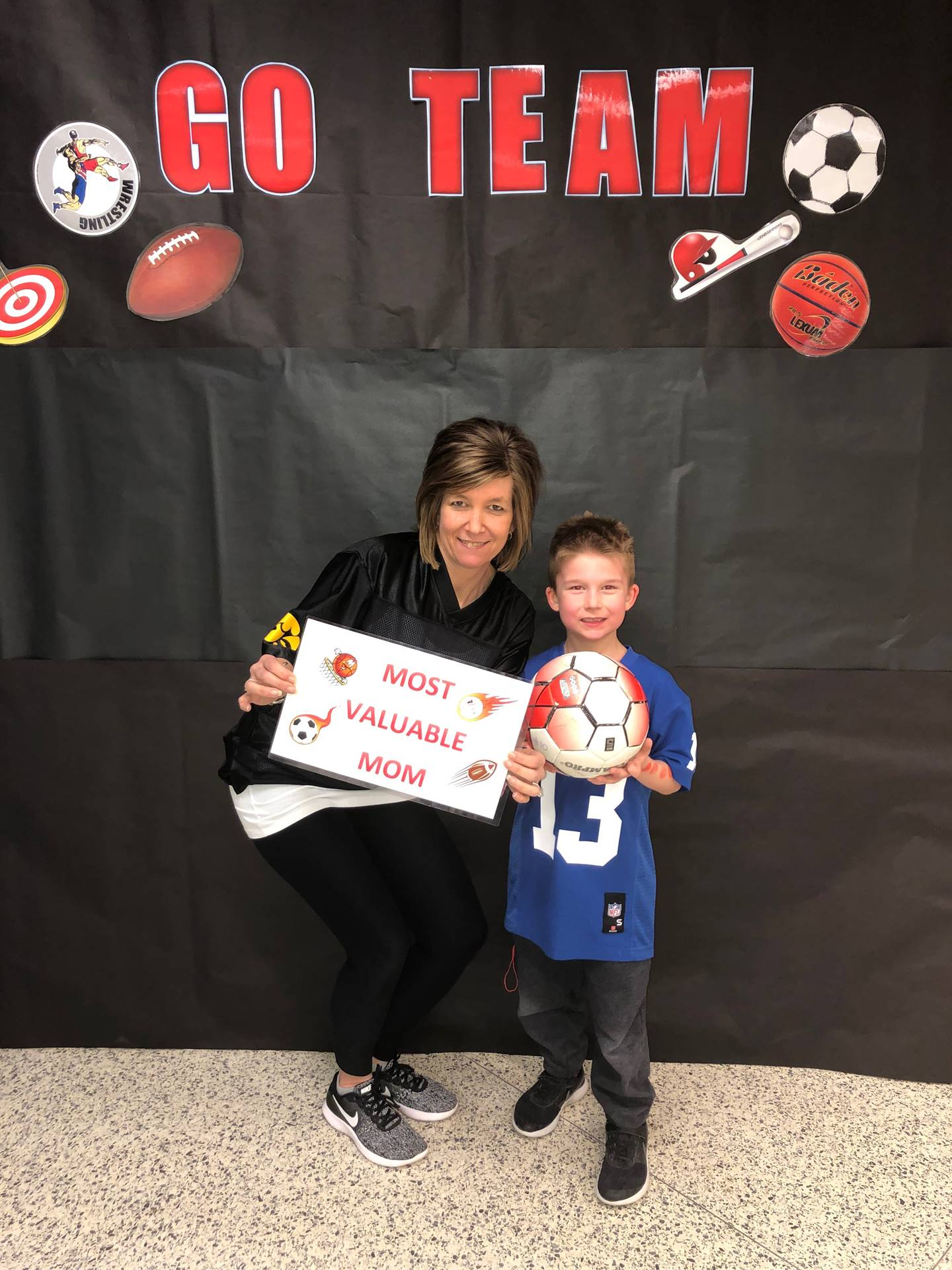 Mother and Son posing for pictures for Sports night at school