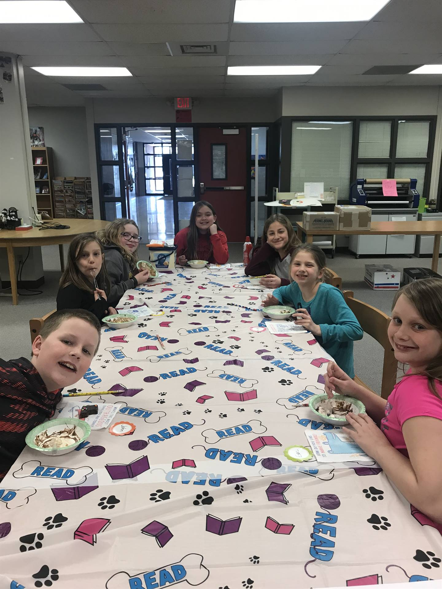 Students eating brownies in Library for celebration of reading books