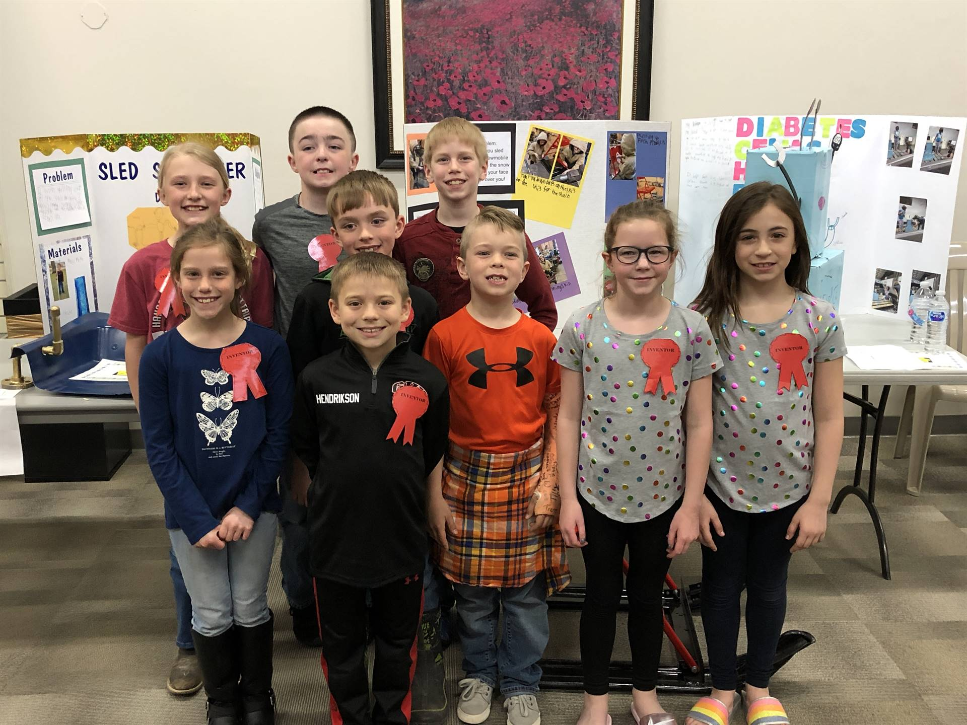 9 students lined up for picture of Invention Convention Winnters