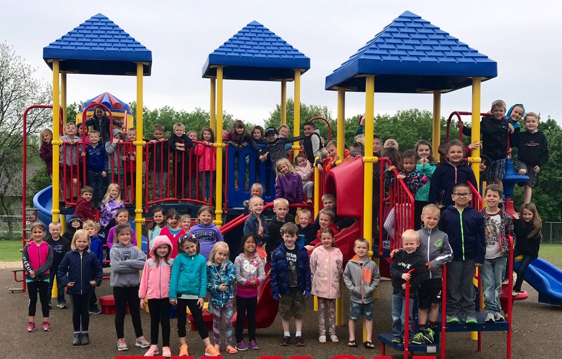 TK-Kindergarten Students lined up on playground for class photo