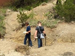 2 students searching for fossils at Fossil and Prairie Center for field trip