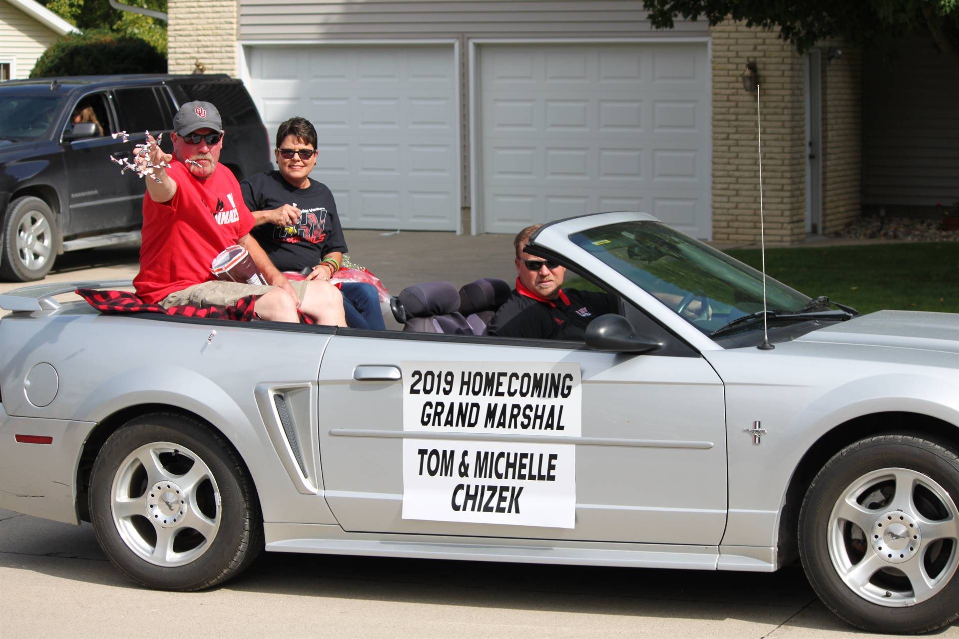 convertible in parade with grand marshal