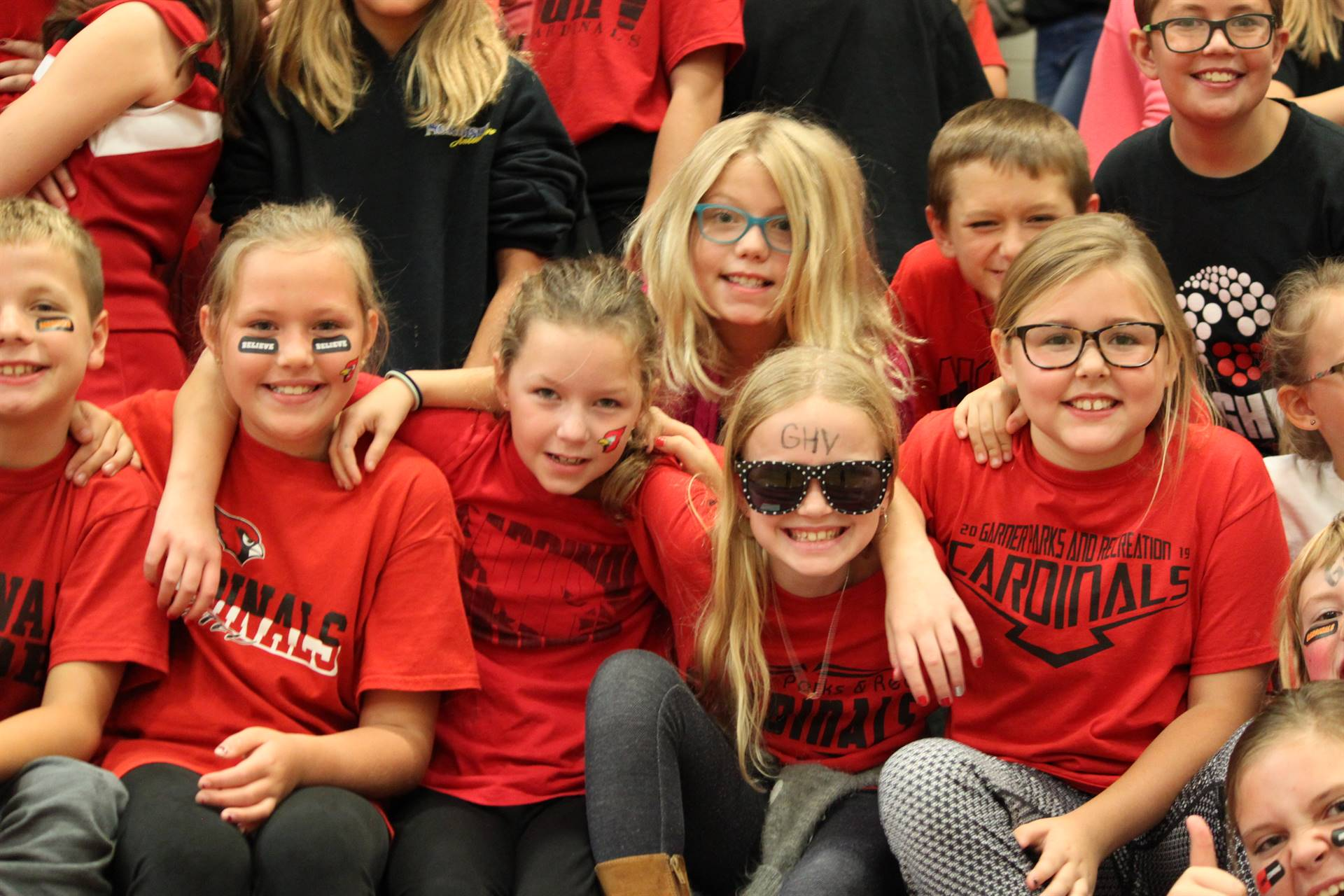 fourth grade students in bleachers watching pep rally