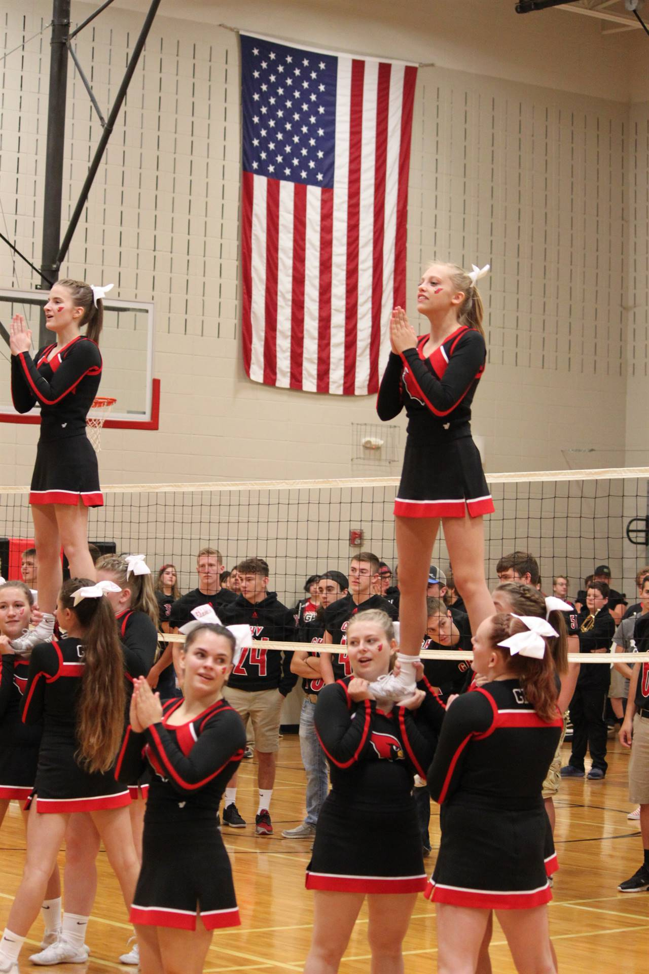 high school cheerleaders cheering at elementary pep rally