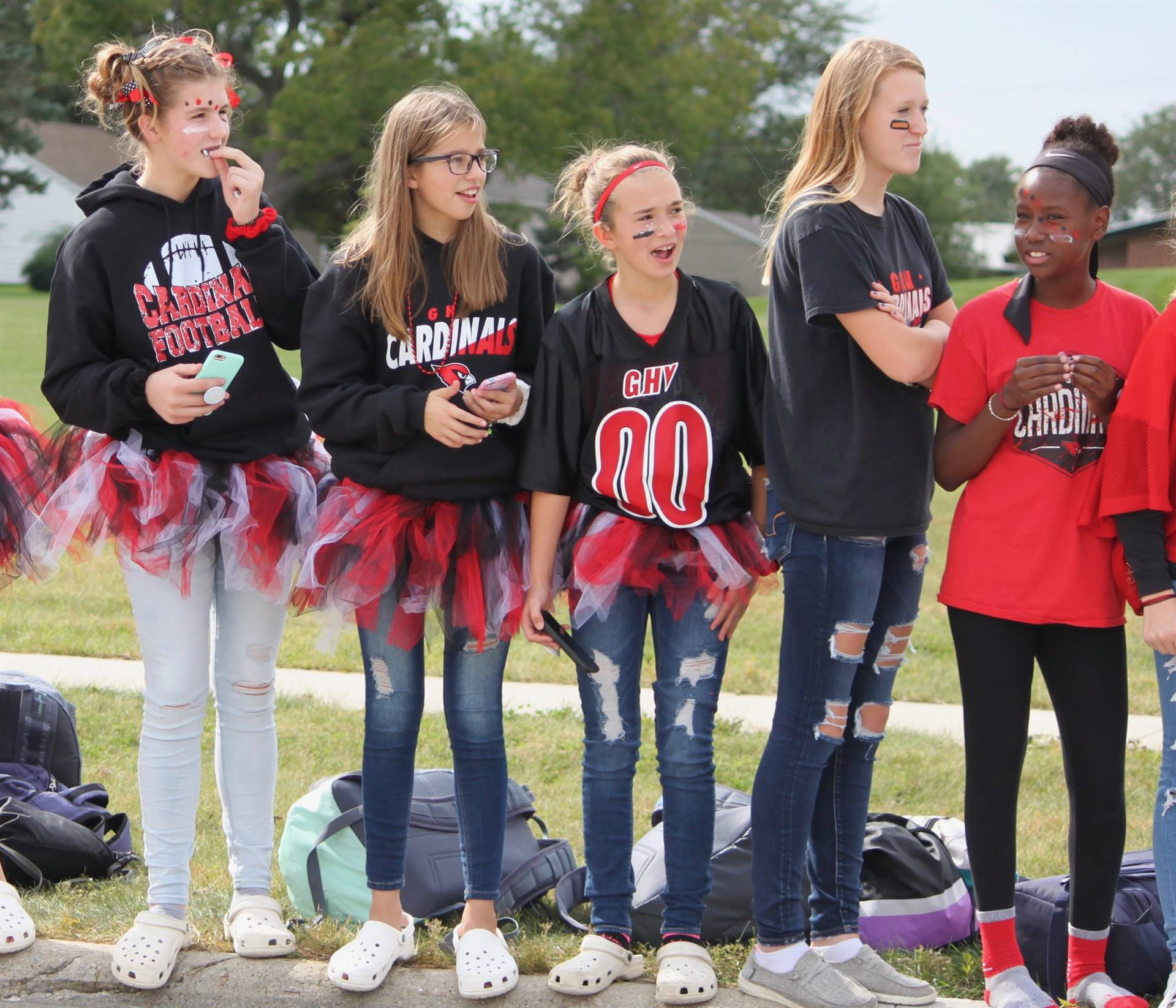 five middle school girls watching homecoming parade