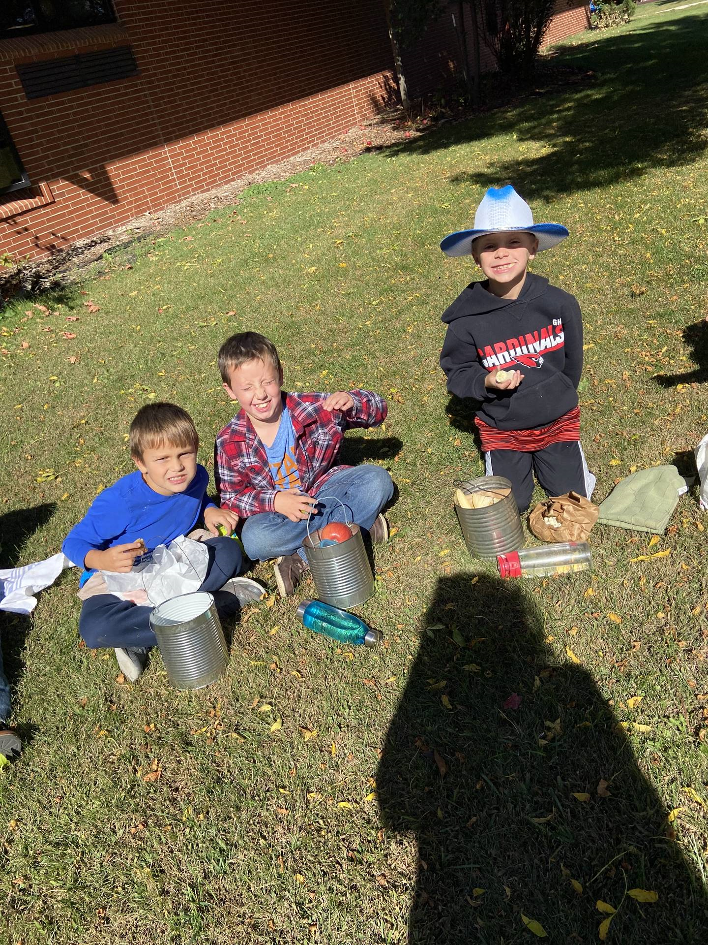 Second grade students dressed as pioneers having lunch