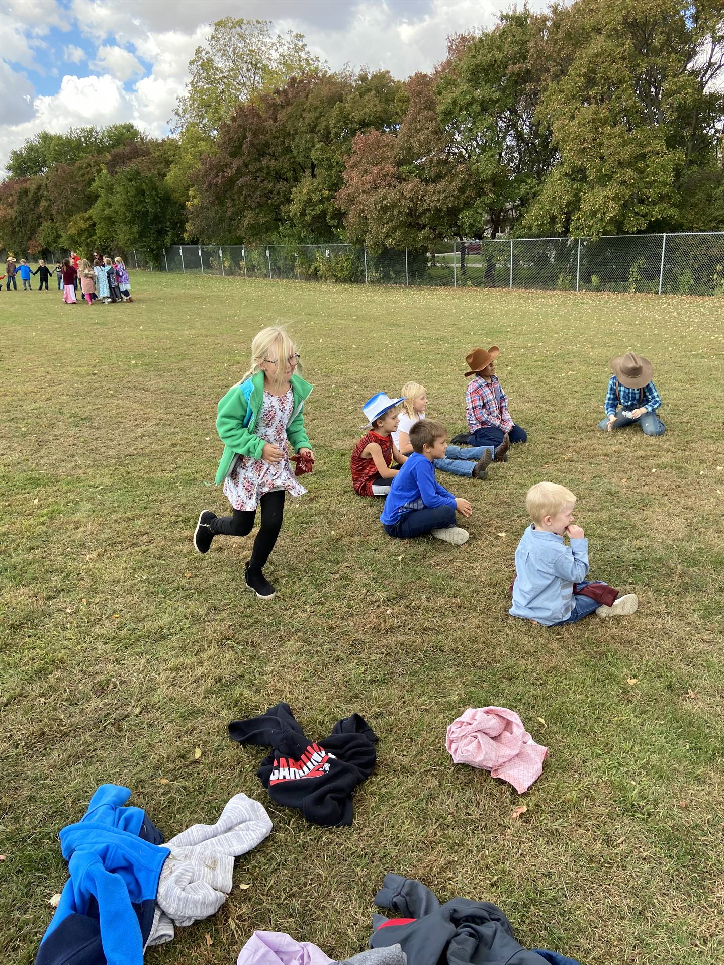 Second grade students dressed as pioneers playing games outside