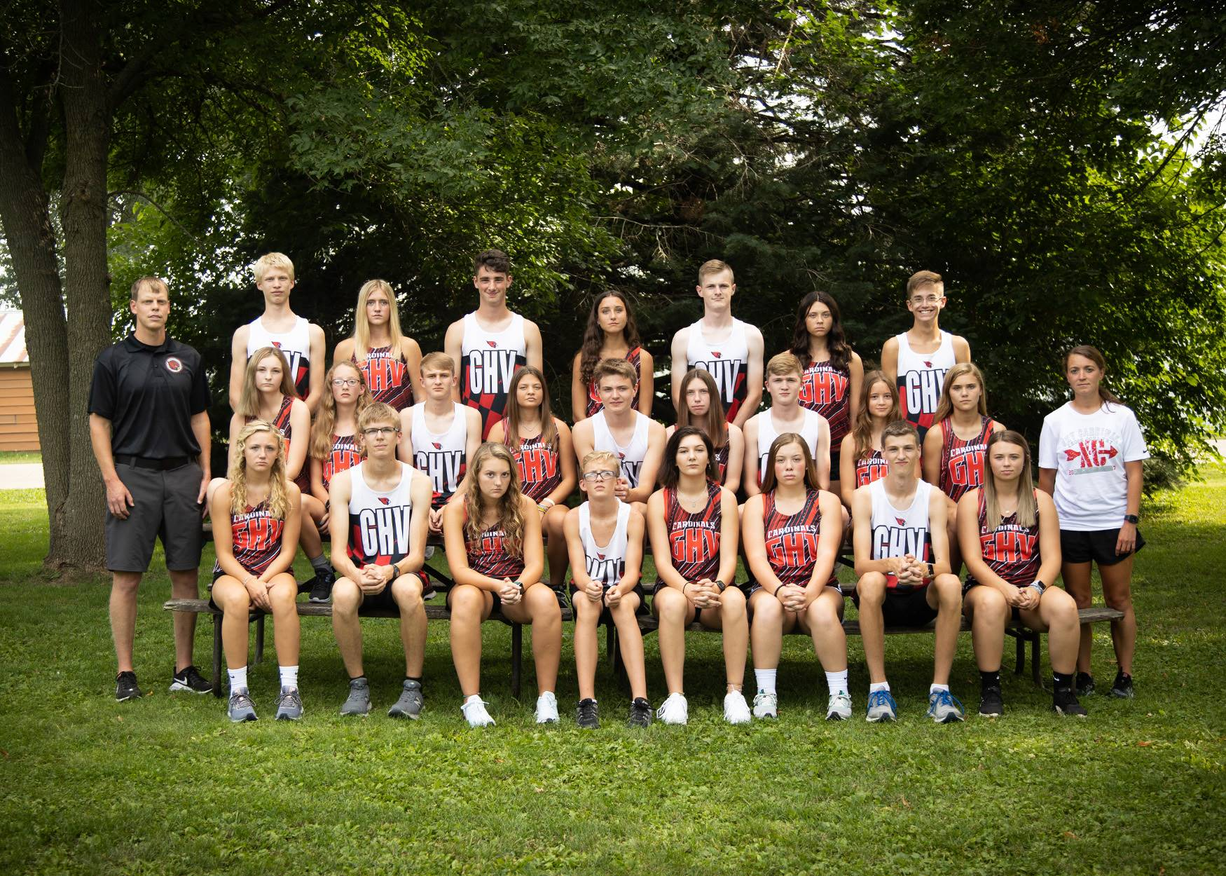 cross country runners lined up for a team photo