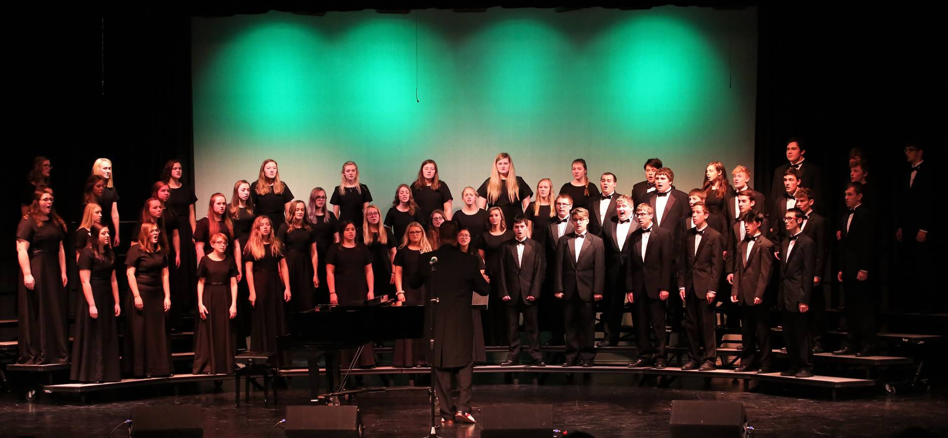 student choir on risers singing at a concert