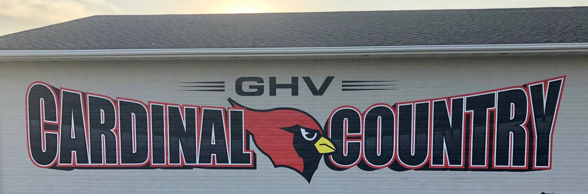 photo of cardinal country logo painted on concession stand building
