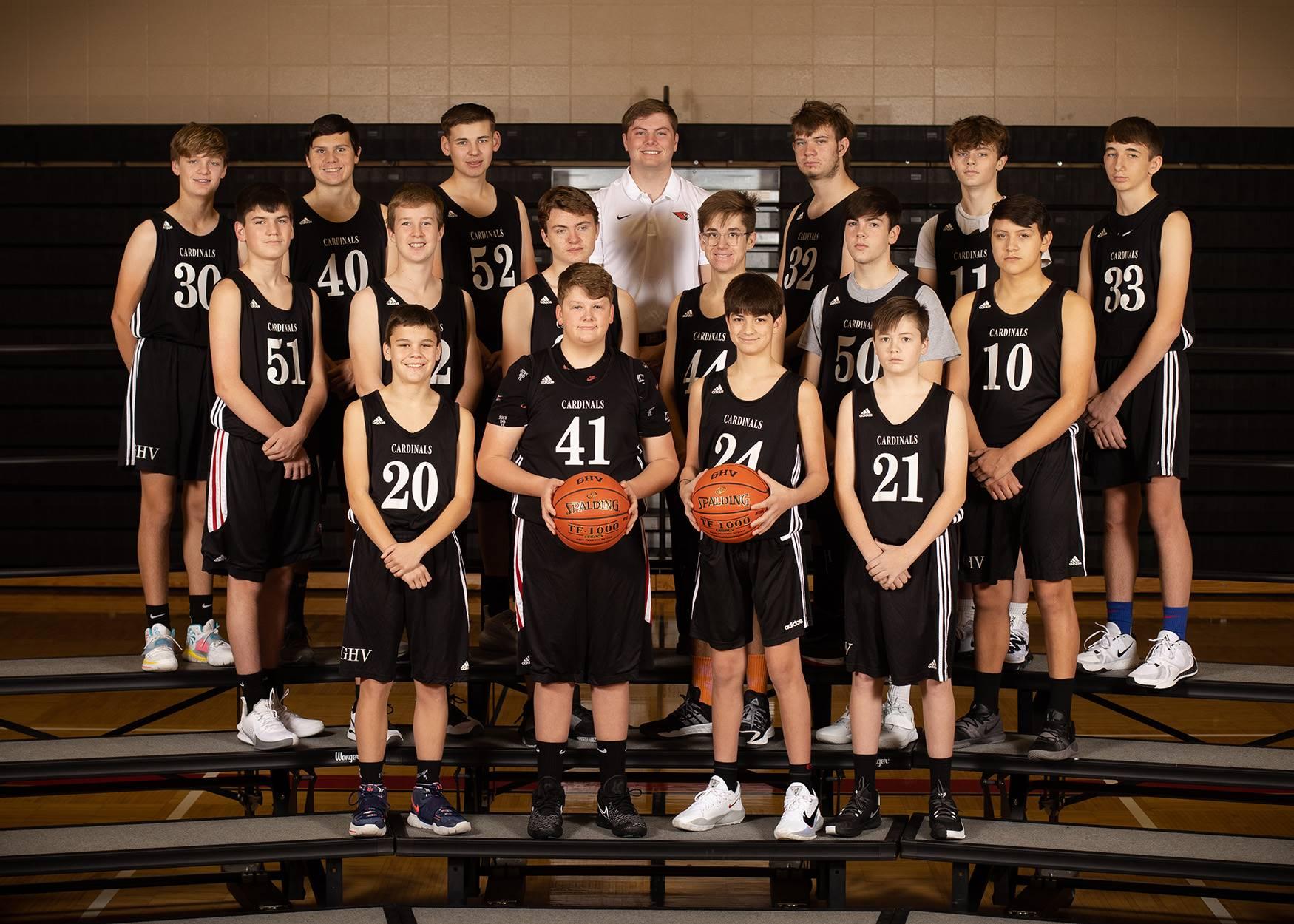 Boys Basketball team posing for a photo