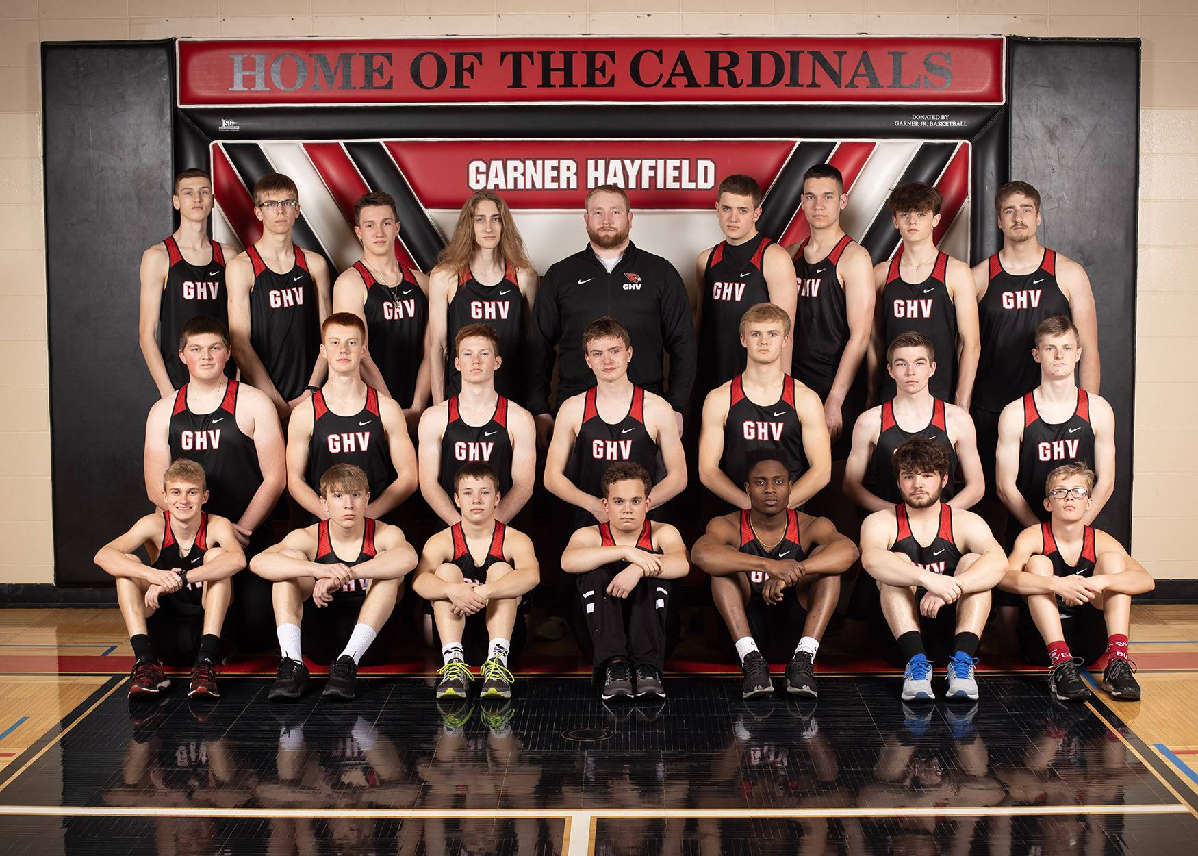 Boys track team posing for a photo