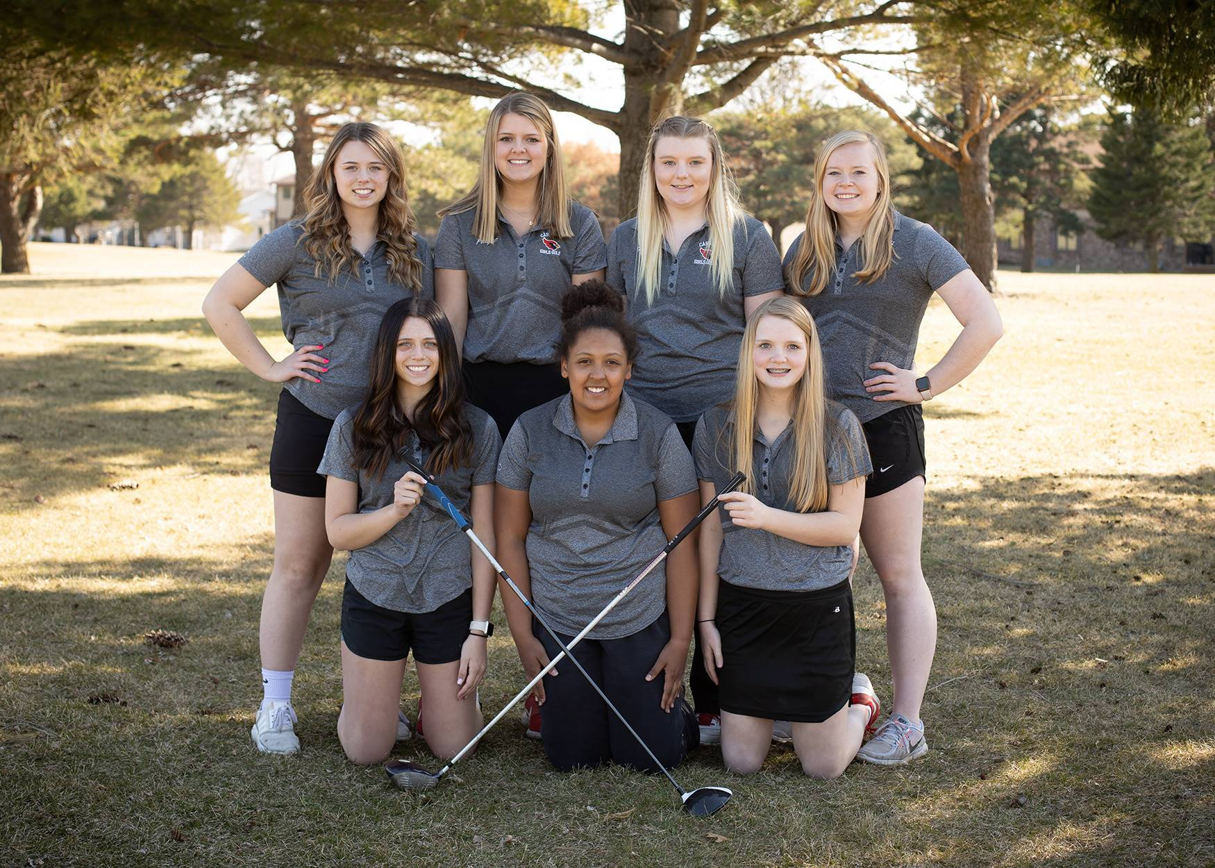 Girls golf team posing for a photo