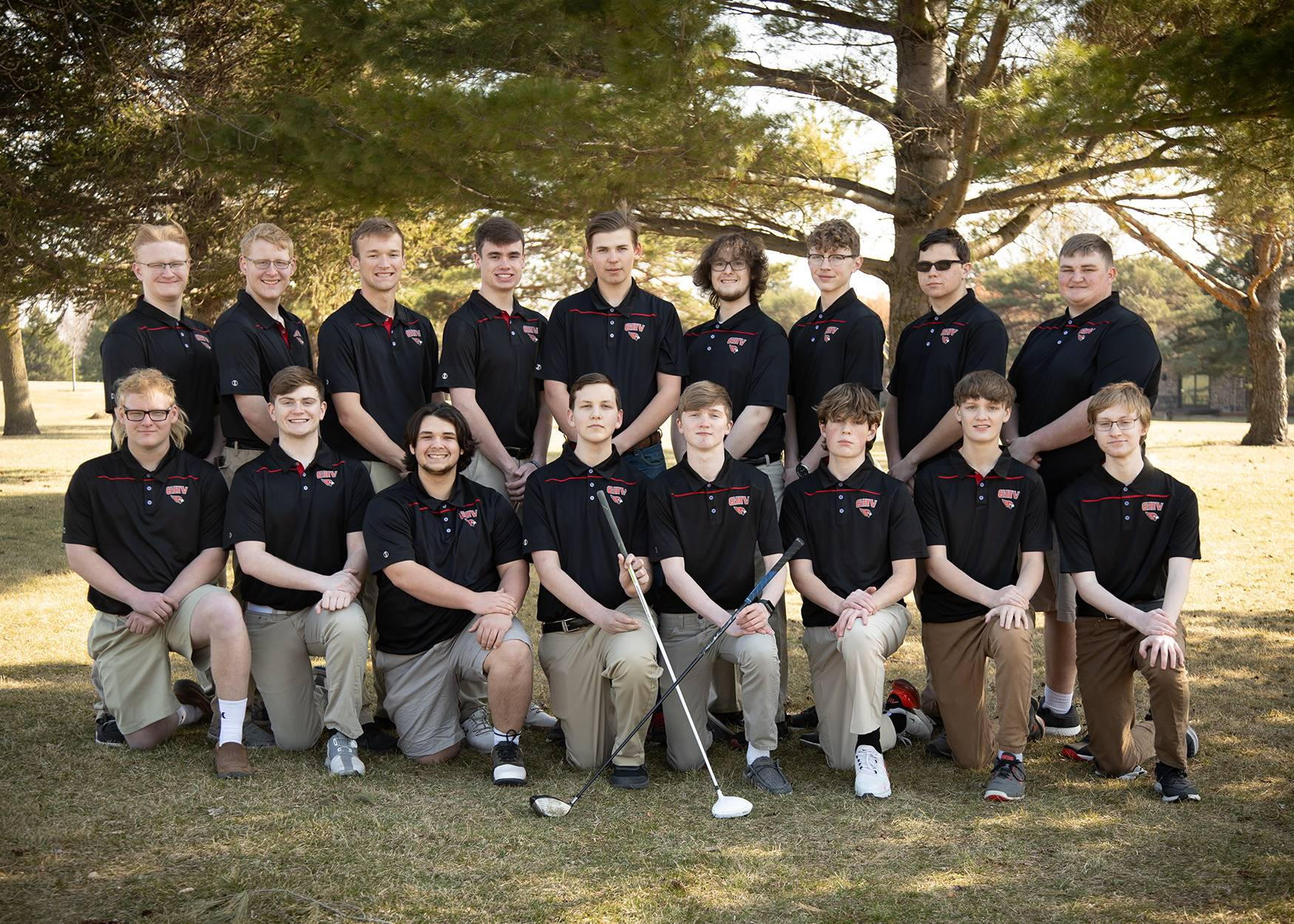 Boys golf team posing for a photo