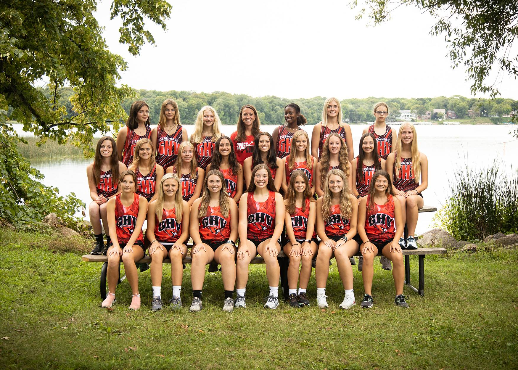 Girls cross country runners posing for a group photo