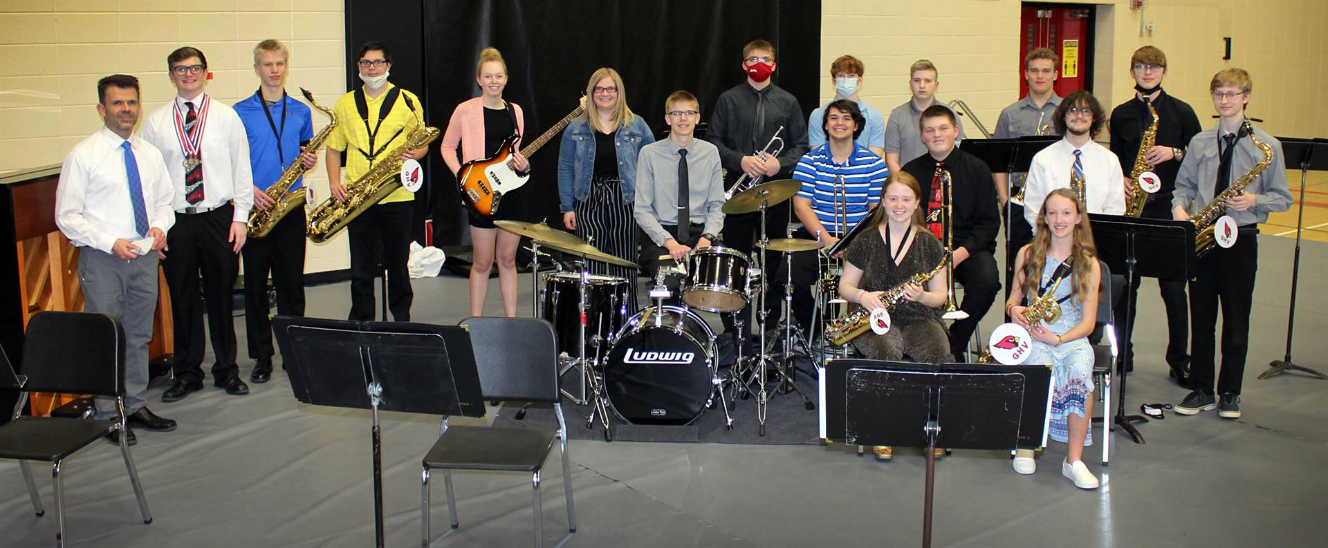 Jazz band students posing for a photo with their musical instruments
