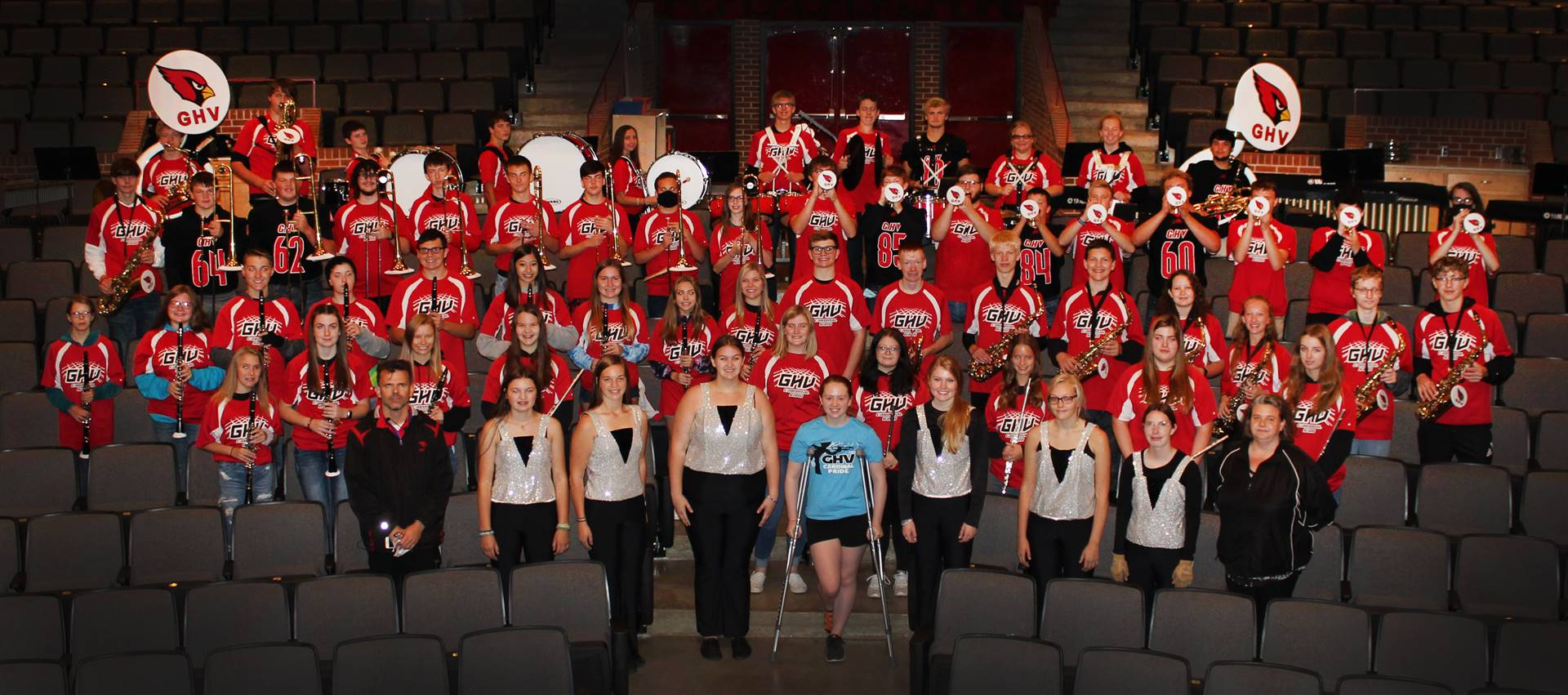 High school band posing for a photo in the auditorium