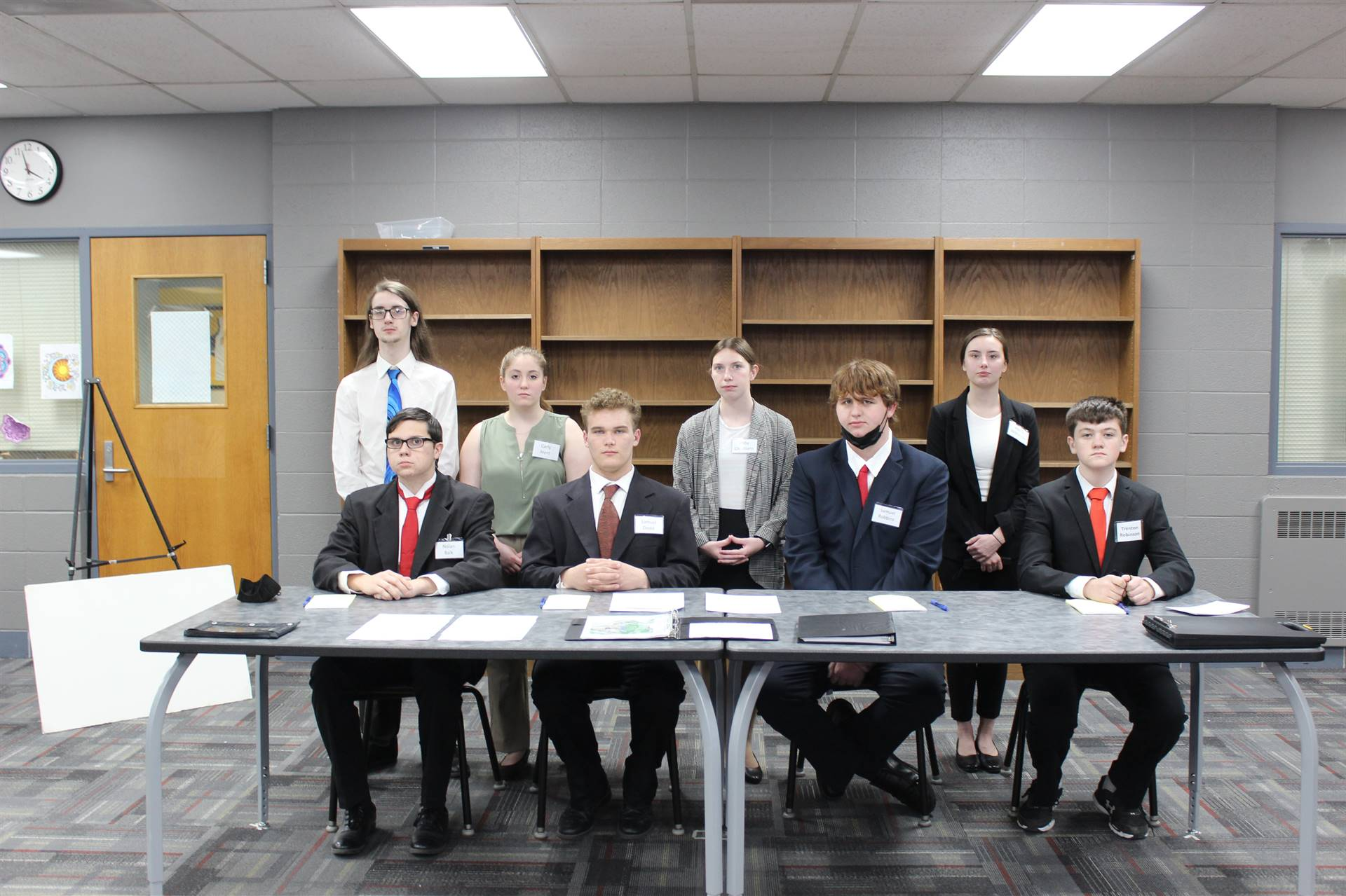 Mock Trial students sitting behind table