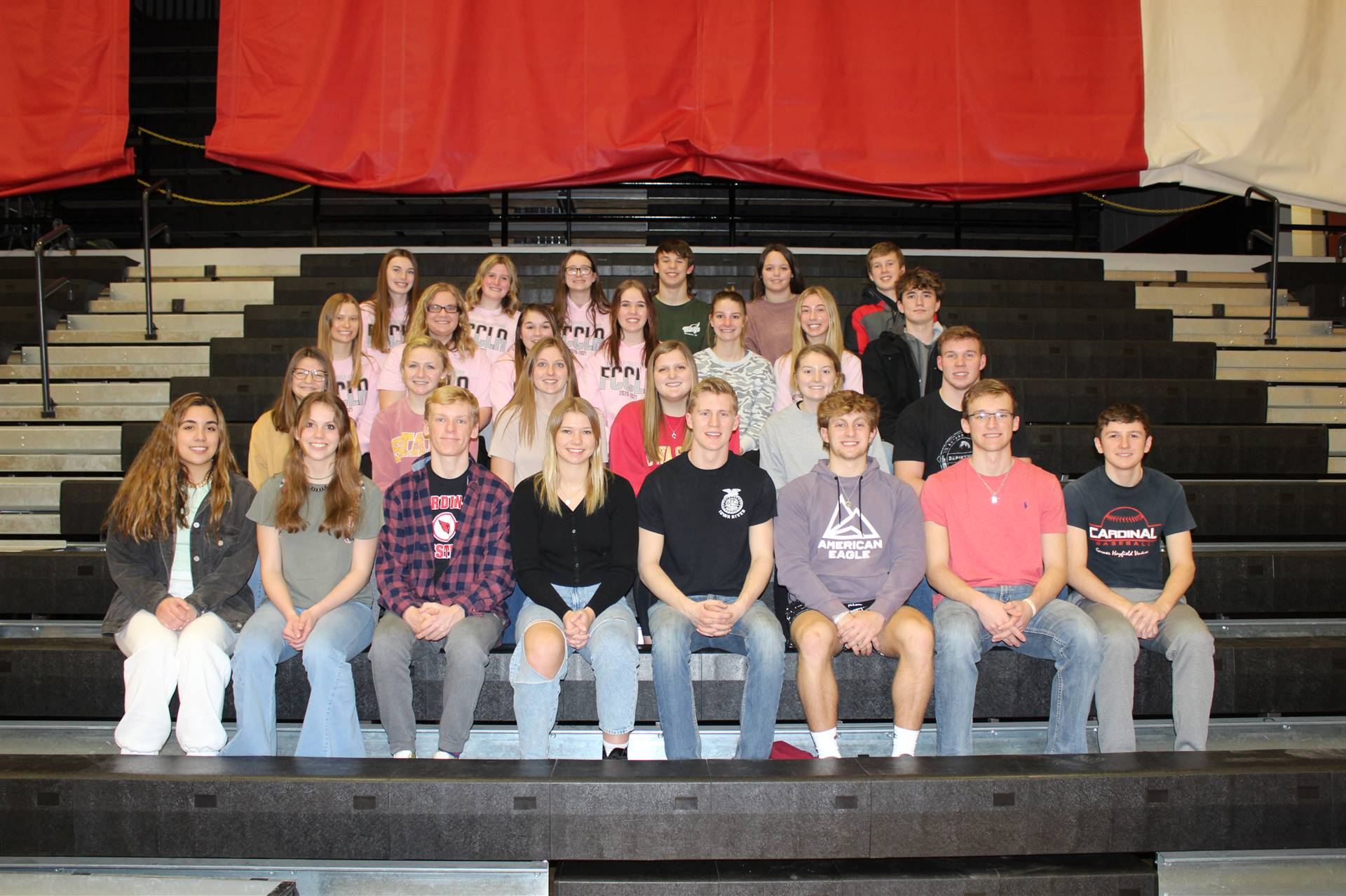student council students posing for a group photo on risers
